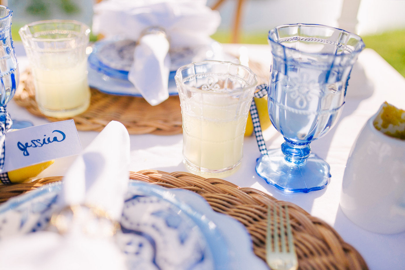 blue, white, and yellow tables cape with homemade lemonade in a glass pitcher