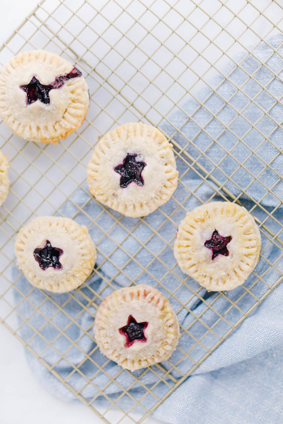 A simple and delicious homemade cherry and blueberry hand pie recipe by Lauren Cermak of Going For Grace. This recipe is the perfect addition to any meal!