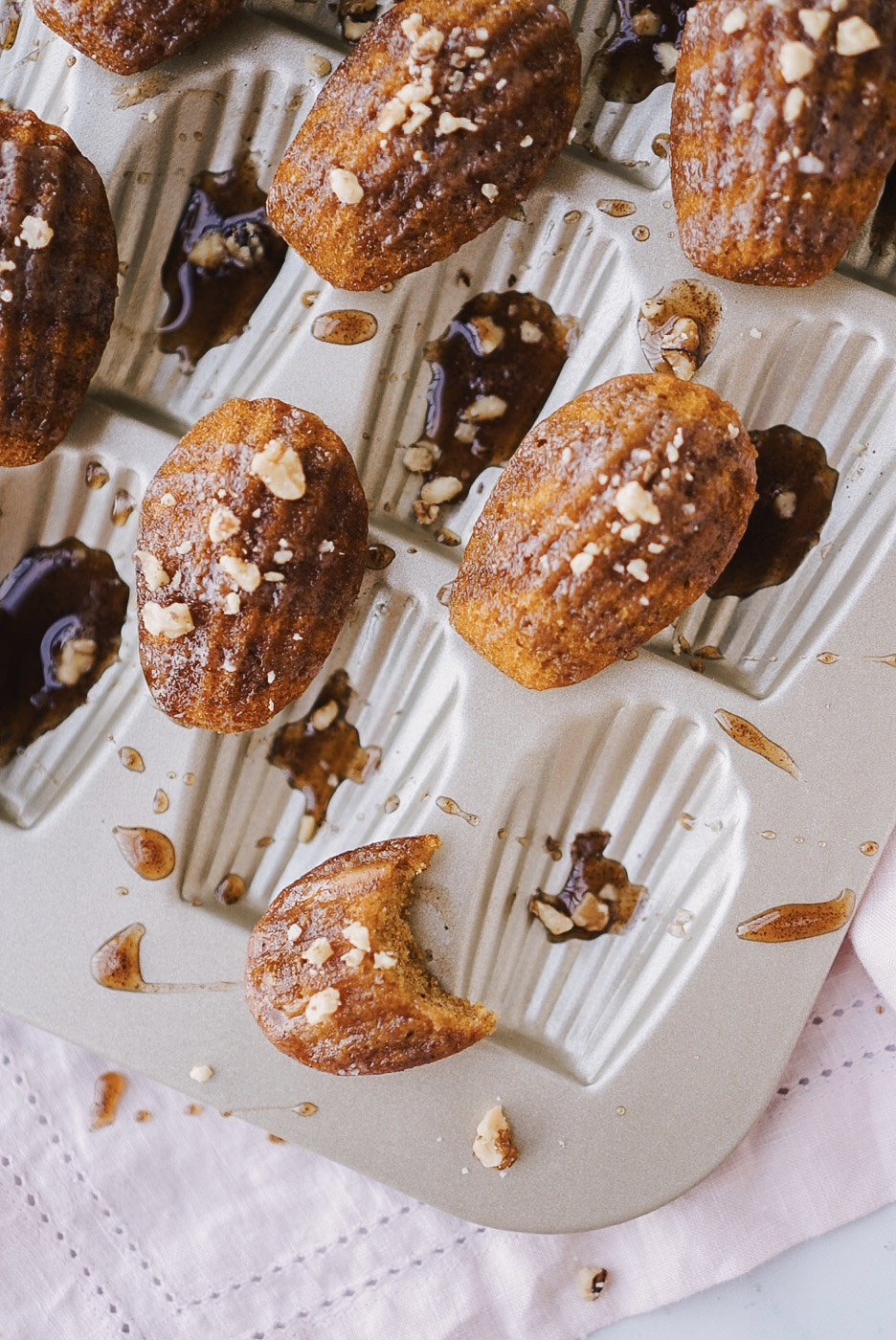 A recipe for pumpkin spice madeleines with maple glaze by Lifestyle blogger Lauren Cermak of Going For Grace. The perfect way to celebrate the Fall season!