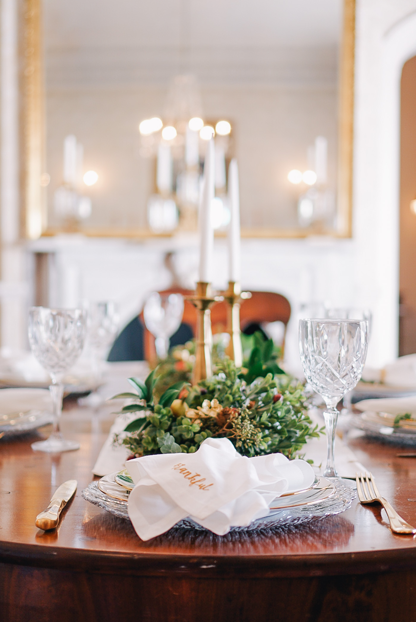 A Thanksgiving tablescape full of Fall garland by Lauren Cermak of the Southern lifestyle blog, Going For Grace.