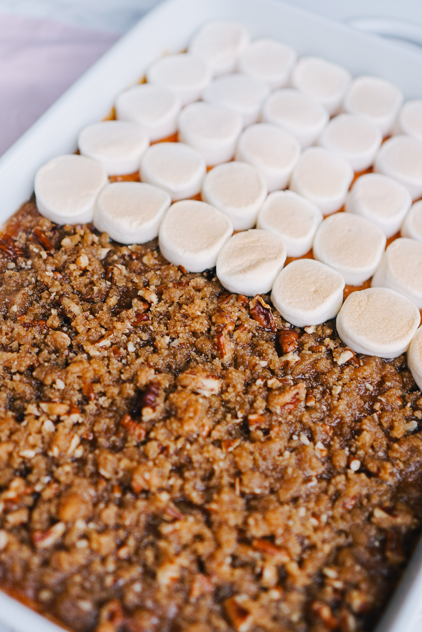 A creative twist on sweet potato casserole for marshmallow and crumble topping lovers alike by Lauren Cermak of the Southern lifestyle blog, Going For Grace.