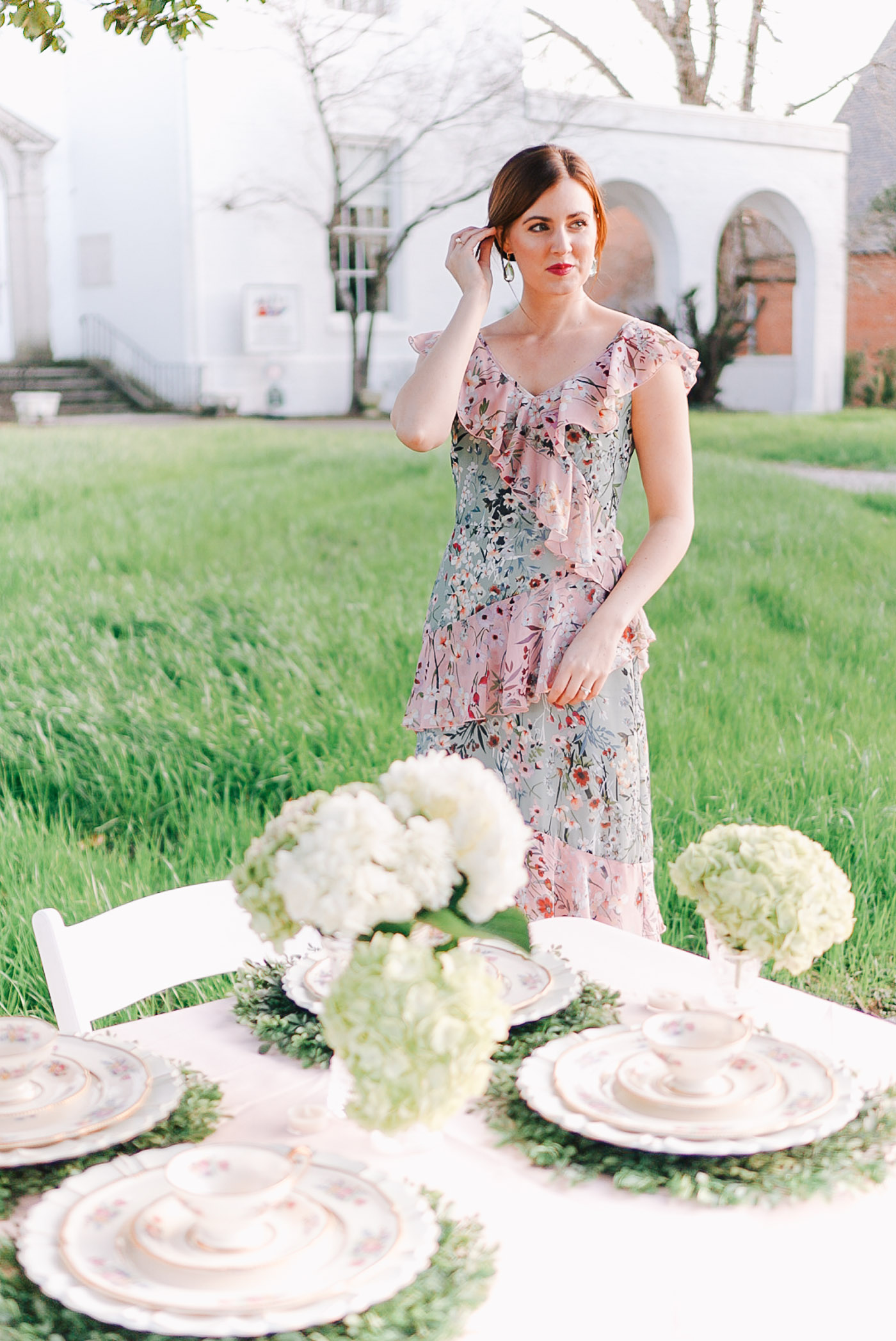 A floral bridal tea table setting by lauren cermak of the southern lifestyle blog Going For Grace.