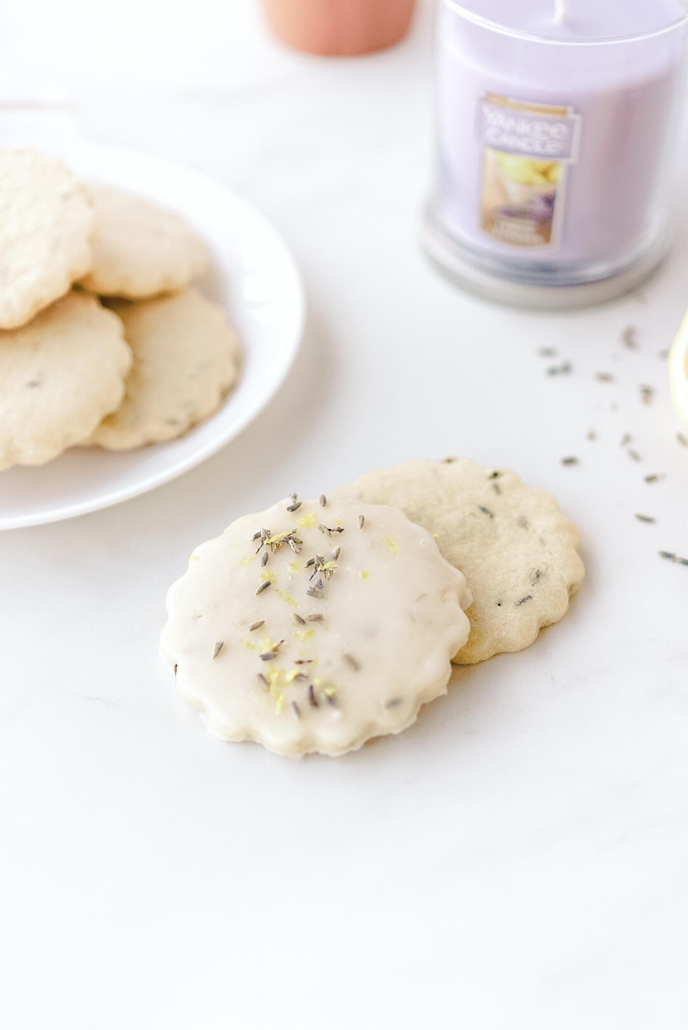 lemon lavender glazed cookies on white marble counter