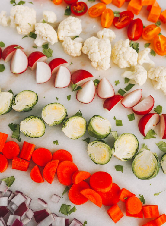 fresh cut vegetables on white marble counter
