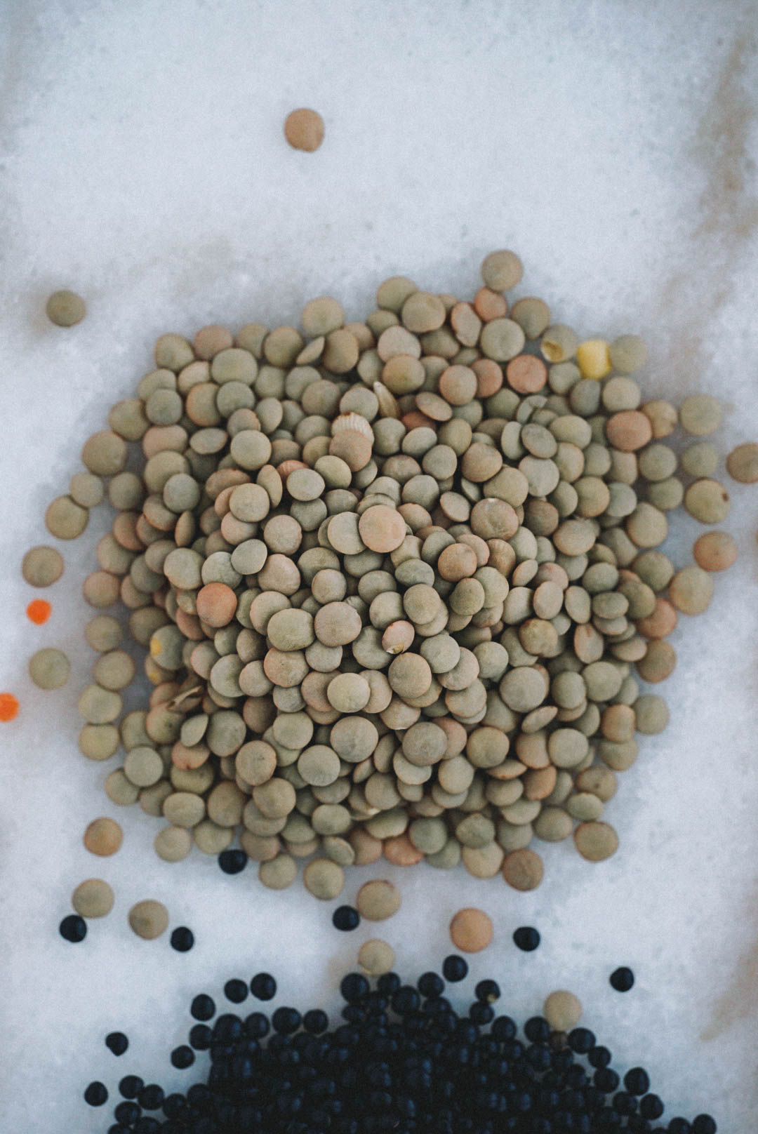 green lentils on white marble counter