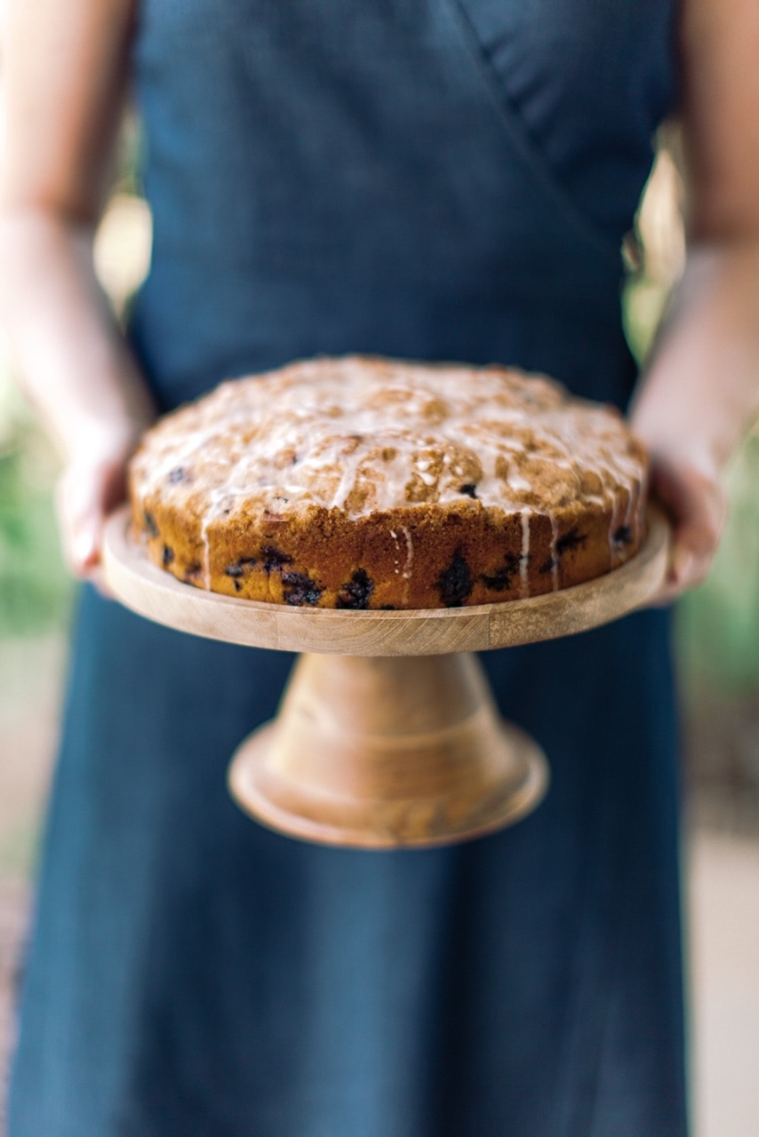 blueberry coffee cake recipe on wood cake stand